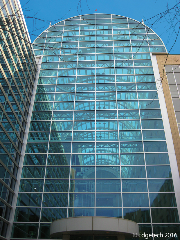 Glass atrium perfect a glass elevator in the atrium of for Quanex building products